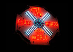 This beautiful original neon sign is at the rear of the Crossroads property.