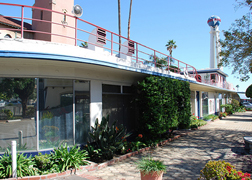 Rounded corners, red railings and blue tiles are some of the Streamline Moderne features on the Crossroads ocean liner.