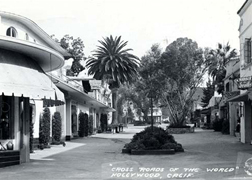 The Crossroads east courtyard looking north from Sunset Blvd.  Note the Barber of Seville shop on the right.